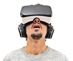 A guy wearing Virtual Reality glasses