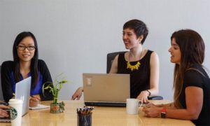 Three ladies working in a meeting room
