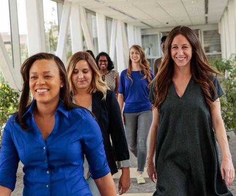 Women smiling and walking