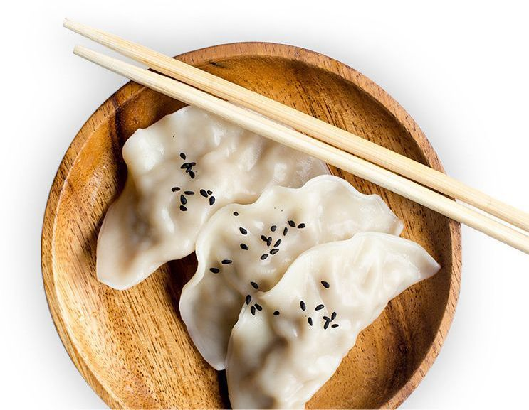 Three dumplings in a bow with two chopsticks