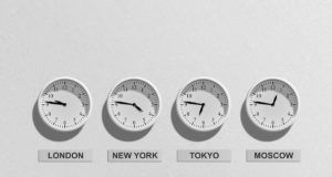 Four clocks showing different times zones
