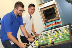 Guys playing foosball
