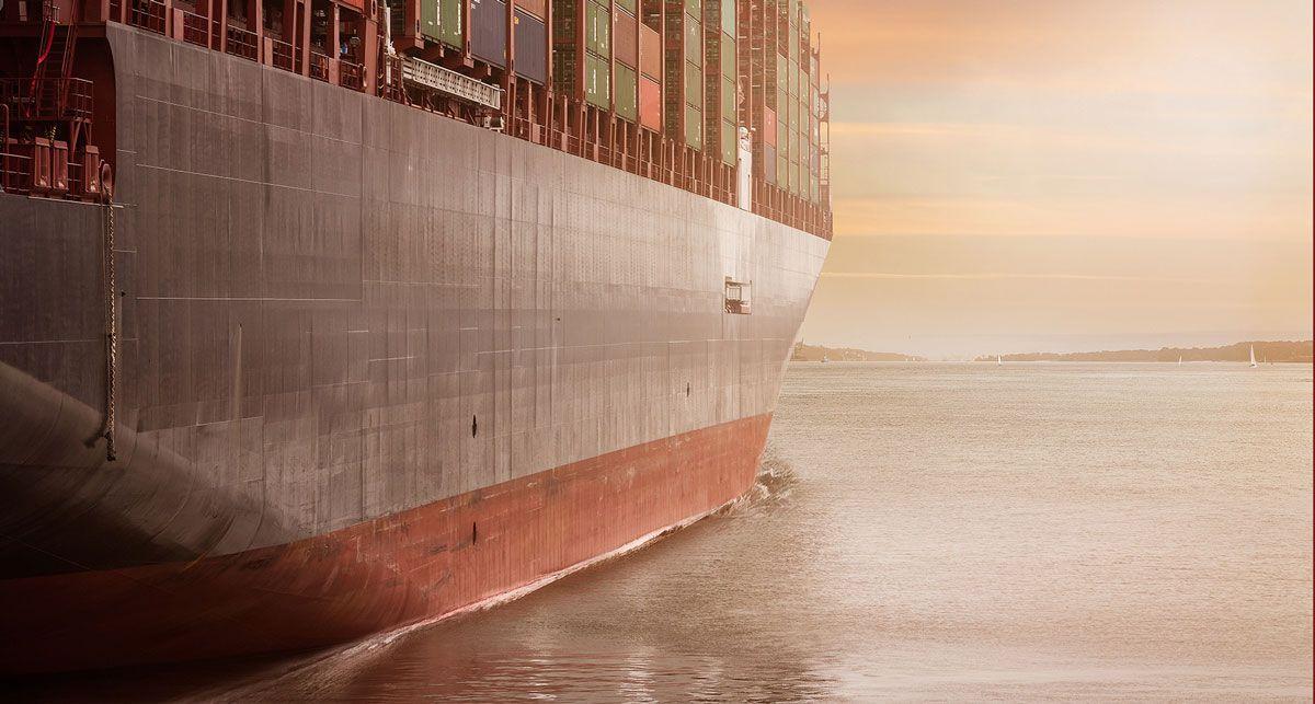 The bottom of a cargo ship in the sea