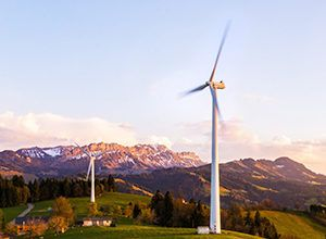 Windmills in the country side with a mountain at the background