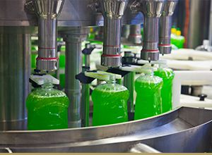 Bottles being filled in by a machine