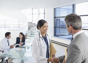 Doctor greets a man
