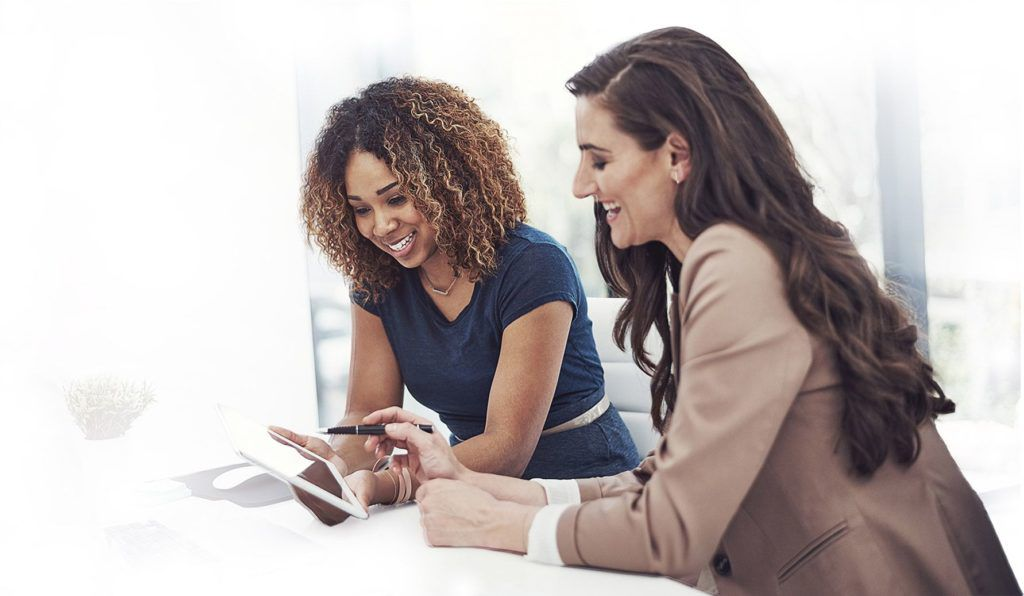 Two ladies looking at an iPad
