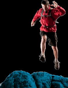 A man jumping on rocks