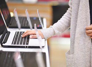 A woman choosing a laptop