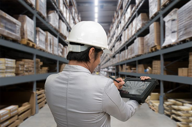 Person with a tablet working in a warehouse